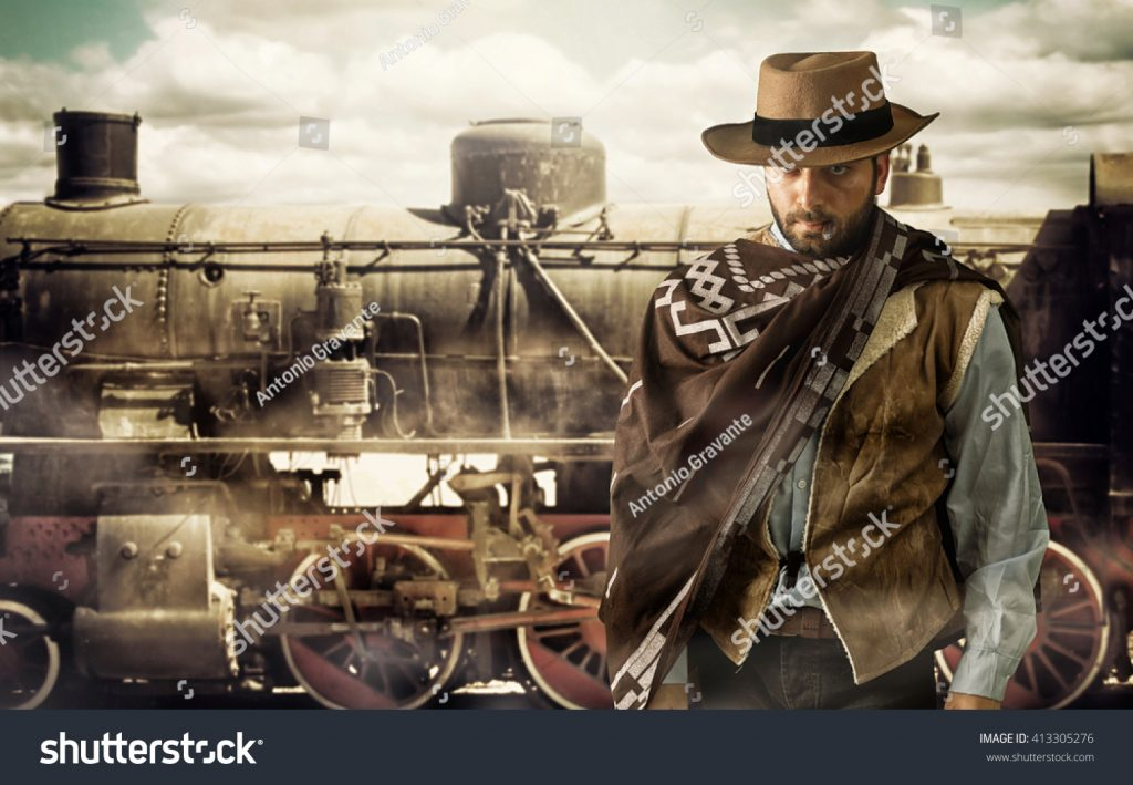 stock-photo-gunfighter-of-the-wild-west-at-the-train-station-413305276