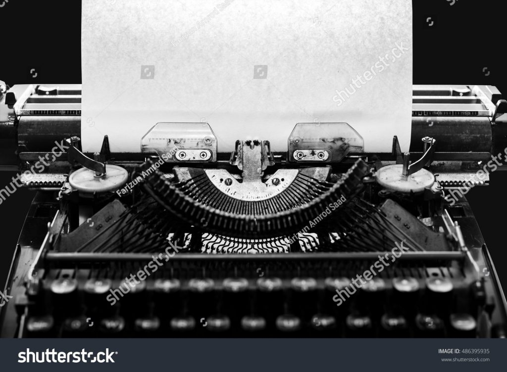 stock-photo-typewriter-with-paper-sheet-with-black-background-space-for-your-text-486395935